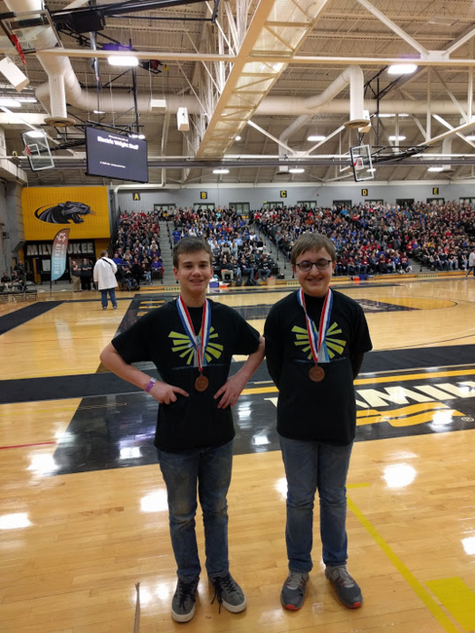 Killian Poquette and Nathan Seefeld medal in the Density Lab event during the Science Olympiad State Tournament